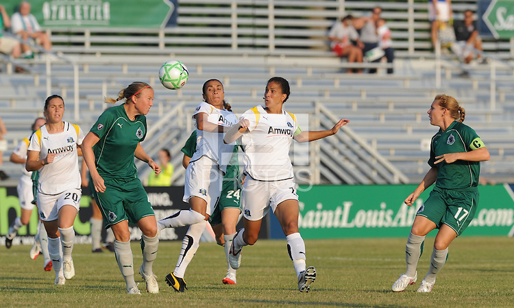 Sara Larsson clears the ball from Marta and Shannon Boxx..Saint Louis Athletica were defeated 2-1 by LA Sol, at Anheuser-Busch Soccer Park, Fenton, Missouri.