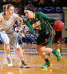 BROOKINGS, SD - JANUARY 31:  Marena Whittle #32 from North Dakota State University drives against Chynna Stevens #0 from South Dakota State University in the first half of their game Saturday afternoon at Frost Arena in Brookings. (Photo by Dave Eggen/Inertia)
