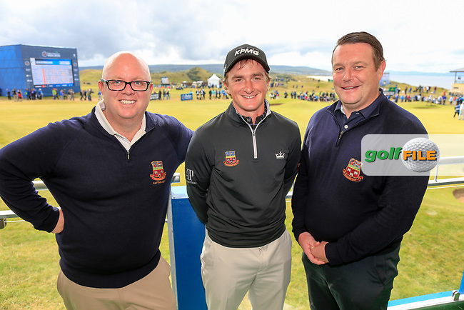 Paul Dunne (IRL) showing off his top with St Annes golf club logo who won the Bank of Ireland sponsor for a day pictured with Club Captain Ben Headon and club manager Niall Carroll after round 2 at the Dubai Duty Free Irish Open hosted by the Rory Foundation, at Portstewart Golf Club, Portstewart, Co. Derry, Northern Ireland. 07/07/2017<br /> Picture: Golffile | Fran Caffrey<br /> <br /> <br /> All photo usage must carry mandatory copyright credit (&copy; Golffile | Fran Caffrey)