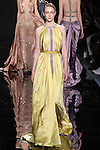 """Model walks runway in a saffron silk charmeuse draped dress with embroidered detail from the Reem Acra Fall 2016 """"The Secret World of The Femme Fatale"""" collection, at NYFW: The Shows Fall 2016, during New York Fashion Week Fall 2016."""