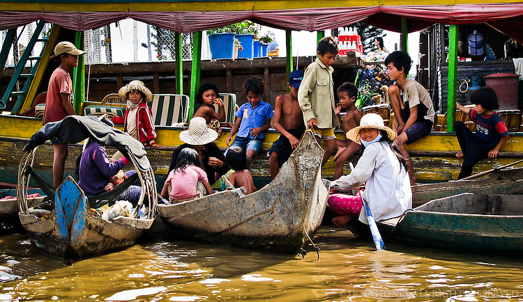 The floating market on Lake Tonle Sap serves as a daylong hangout for the lake's refugee children.