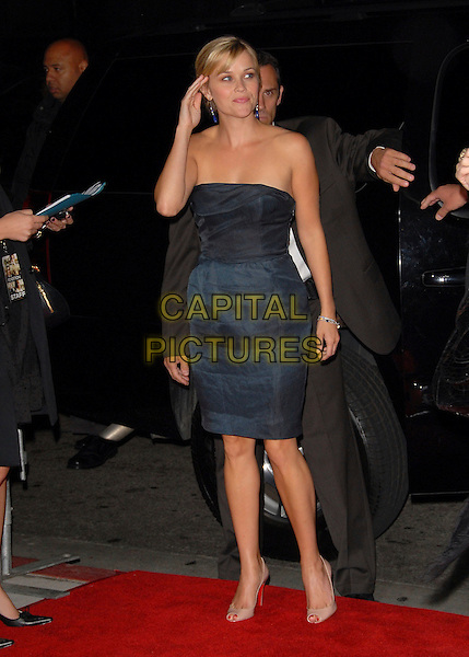 REESE WITHERSPOON.Newline Cinema's L.A. Premiere of Rendition held at The Academy of Motion Picture Arts & Sciences in Beverly Hills, California, USA..October 10th, 2007.full length black blue strapless dress cream shoes hand.CAP/DVS.©Debbie VanStory/Capital Pictures