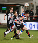 Alex Whittle hauls back Jon Daly in the box