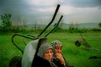 MACEDONIA. Tabanovce. 25 May 2001..Ethnic Albanian villagers from the rebel held village of Vaksince  rest in a field after fleeing the village which had been under bombardment by the Macedonian Army for three weeks..©Andrew Testa