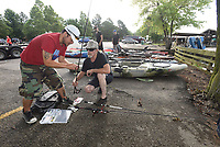 NWA Democrat-Gazette/FLIP PUTTHOFF<br />Timothy Dohack (left) and Tim Riecke select lures for fishing July 8 2017 at Lake Fayetteville. Heroes on the water provides kayaks and tackle for veterans to use.