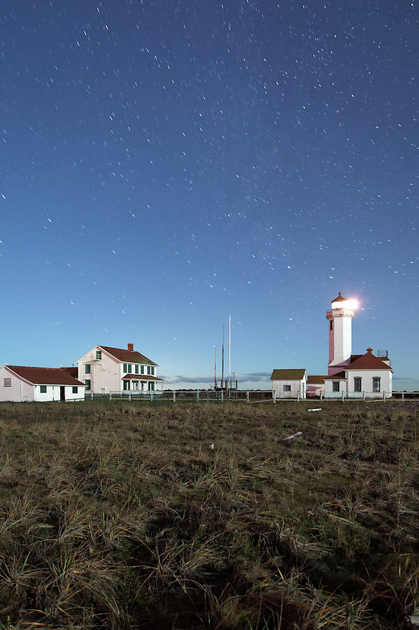 Point Wilson Lighthouse under a starry sky, Fort Worden State Park, Port Townsend, Washington, USA