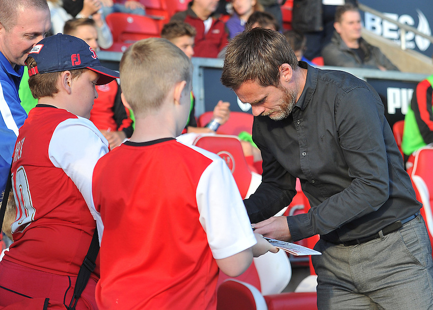 Fleetwood Town's Manager Graham Alexander signs young fans programs<br /> <br /> Photographer Dave Howarth/CameraSport<br /> <br /> Football - Capital One Cup First Round - Fleetwood Town v Hartlepool United - Tuesday 11th August 2015 - Highbury Stadium - Fleetwood<br />  <br /> &copy; CameraSport - 43 Linden Ave. Countesthorpe. Leicester. England. LE8 5PG - Tel: +44 (0) 116 277 4147 - admin@camerasport.com - www.camerasport.com