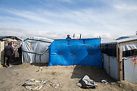 """Calais Jungle Camp.<br /> <br /> Under the Sky of Calais & Dunkirk. Two Camps, Two Sides of the Same Coin: Not 'migrants', Not 'refugees', just Humans.<br /> <br /> France, 24-30/03/2016. Documenting (and following) Zekra and her experience in the two French camps at the gate of the United Kingdom: Calais' """"Jungle"""" and Dunkirk's """"Grande-Synthe"""". Zekra lives in London but she is originally from Basra in Iraq. Zekra and her family had to flee Kuwait - where they moved for working reason - due to the """"Gulf War"""", and to the Western Countries' will to """"export Democracy in Iraq"""". Zekra is a self-motivated volunteer and founder of """"Happy Ravers"""", a group of people (not a NGO or a charity) linked to each other because of their love for rave parties but also men and women who meet up every week to help homeless people and other people in need in Central London. (Here there are some of the stories I covered about Zekra and """"Happy Ravers"""": http://bit.ly/1XVj1Cg & http://bit.ly/24kcGQz & http://bit.ly/1TY0dPO). Zekra worked as an English teacher in the adult school at Dunkirk's """"Grande-Synthe"""" camp and as a cultural mediator and Arabic translator for two medic teams in Calais' """"Jungle"""". Please read her story at the beginning of this reportage."""