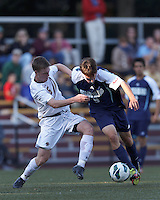University of Rhode Island (URI) forward Jamie Eckmayer (9) on the attack as Boston College midfielder Jason Abbott (6) defends. Boston College defeated University of Rhode Island, 4-2, at Newton Campus Field, September 25, 2012.