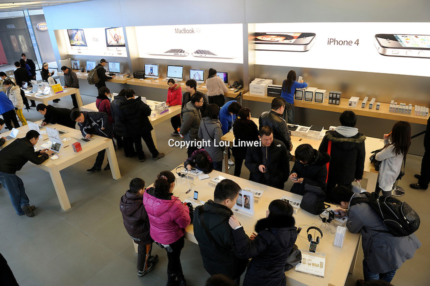 Consumers trying out different products in Apple Store in Beijing, China. China Realtime Report says that Chinese Apple Stores are big business for the company, averaging 40,000 visitors per day that's more than four times the traffic of Apple's U.S. stores, its stores brought in a reported US$2.6 billion last quarter, the best numbers from any of their stores worldwide. By 2012, Apple will meet its goal 25 China Apple stores...