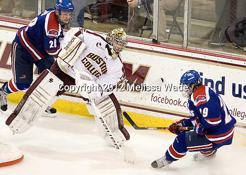 Jake Suter (UML - 28), Parker Milner (BC - 35), Derek Arnold (UML - 29) - The Boston College Eagles defeated the visiting University of Massachusetts Lowell River Hawks 6-3 on Sunday, October 28, 2012, at Kelley Rink in Conte Forum in Chestnut Hill, Massachusetts.
