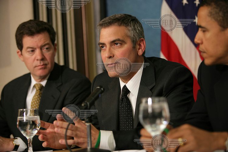 Republican Senator Sam Brownback, actor George Clooney and Democrat Senator Barack Obama at a press conference where they called on Americans to attend 'Save Darfur: Rallies to Stop Genocide' being held across the USA. They also called on the US government and other UN security council members to help end the genocide in Darfur, Sudan, from where Clooney had just returned.