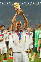 Benedikt Howedes of Germany lifts the World Cup trophy after winning the 2014 final