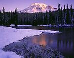 Mt. Rainier National Park, WA     <br /> Sunrise light on Mount Rainier with a fresh layer of snow at Reflection Lake