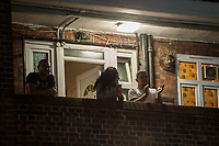 Residents of the Tulse Hill Estate in South London come out onto their balconies to applaud NHS staff fighting the virus 26-3-20