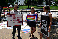 "Washington, DC - July 11, 2016: Members of the group ""We the People for Sensible Gun Laws"" present their message in front of the White House in the District of Columbia, July 11, 2016, to call for changes in federal, state and local gun laws.  (Photo by Don Baxter/Media Images International)"