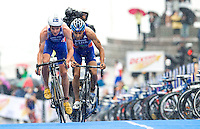 26 AUG 2012 - STOCKHOLM, SWE - Jonathan Brownlee (GBR) (left) of Great Britain leads Vincent Luis (FRA) (right) of France at the start of their final bike lap during the 2012 ITU Mixed Relay Triathlon World Championships in Gamla Stan, Stockholm, Sweden .(PHOTO (C) 2012 NIGEL FARROW)