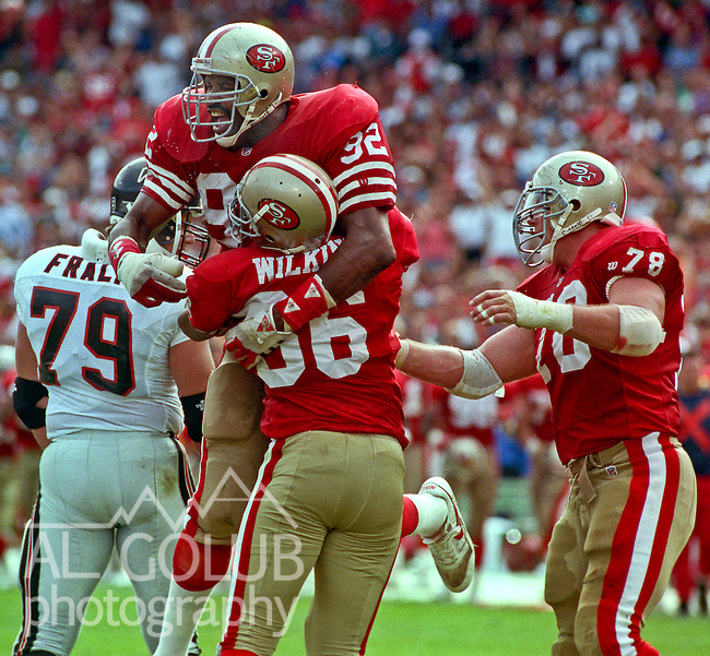 San Francisco 49ers vs. Atlanta Falcons at Candlestick Park Sunday, October 18, 1992.  49ers Beat Falcons 56-17.  San Francisco 49ers linebacker Tim Harris (92) and defensive end David Wilkins (66) celebrate sack.