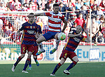Granada's Fran Rico (c) and FC Barcelona's Sergio Busquets (l) and Andres Iniesta during La Liga match. May 14,2016. (ALTERPHOTOS/Acero)