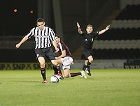 John McGinn evades the tackle from Dylan McGowan as referee David Munro waves play on in the St Mirren v Heart of Midlothian Clydesdale Bank Scottish Premier League U20 match played at St Mirren Park, Paisley on 6.11.12.