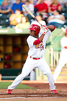 Oscar Taveras (25) of the Springfield Cardinals at bat during a game against the Northwest Arkansas Naturals at Hammons Field on June 14, 2012 in Springfield, Missouri. (David Welker/Four Seam Images)