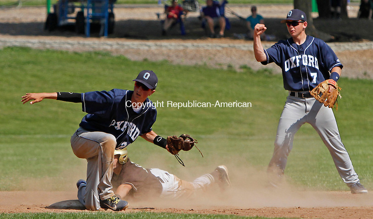 Thomaston, CT-060113MK21 Oxford's Dylan Mitola (2) looks for the call after tagging Thomaston's Aaron Madow (10) as Oxford's Dale Keller (7) looks on during the quarter-final round of class S baseball tournament on Saturday afternoon at Thomaston High School.  Oxford won 11-6. Michael Kabelka / Republican-American