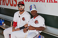 Florida Fire Frogs Jefrey Ramos (left) and Kevin Josephina joke around before a Florida State League game against the Jupiter Hammerheads on April 11, 2019 at Osceola County Stadium in Kissimmee, Florida.  Jupiter defeated Florida 2-0.  (Mike Janes/Four Seam Images)