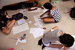 From left: Sharon Choi, 14, Ryan Welch, 12, back, Geetika Guruprasad, 14, back, and Rachael Lee, front right, work from the floor in Geometry Through Art class during Center for Talented Youth summer program at Lafayette College in Easton, PA on July 06, 2012. Several students were part of the Rural Connections scholarship program being offered for the first time this year.