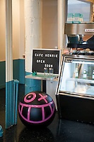 Andr&eacute; Saraiva's new Cafe Henri in Chinatown. By the counter is a Mr. A Ball by the artist. <br /> <br /> Danny Ghitis for The New York Times