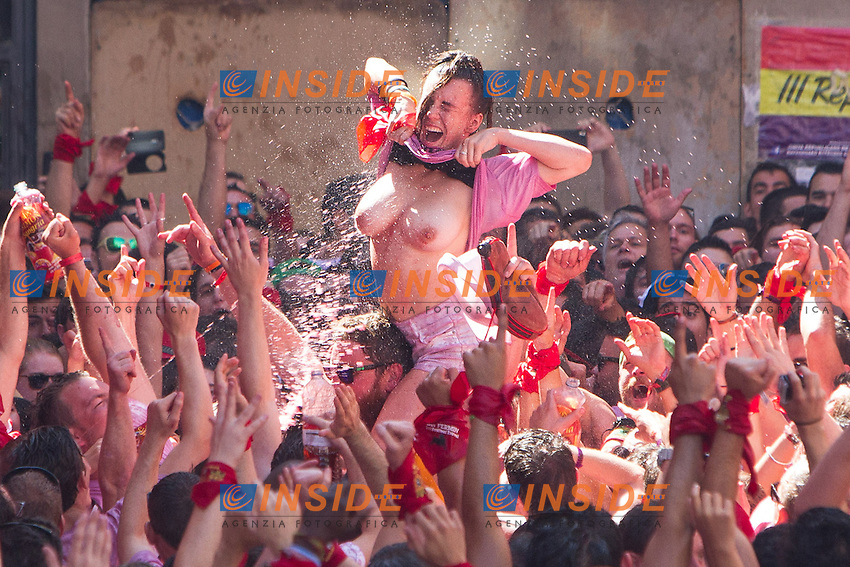Girls show her tits during the rocket launch of San Fermin at the hall square. July 05,2016. (Insidefoto/ALTERPHOTOS/Rodrigo Jimenez <br /> San Firmino Corsa dei Tori