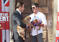 Simon Cowell, David Walliams and their dogs attending a photocall for 'Britain's Got Talent' at St Luke's Church, London. 09/04/2014 Picture by: Alexandra Glen / Featureflash