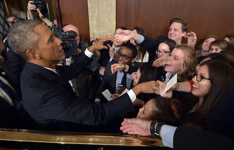 US President Barack Obama shakes hands after delivering the State of the Union address before a joint session of Congress on January 20, 2015 at the US Capitol in Washington, DC. <br /> Credit: Mandel Ngan / Pool