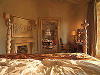 One of the opulent Baroque-inspired bedrooms of the Hotel Borgo Saint Pietro, Italy
