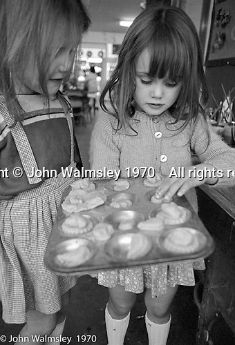 Girls with a baking tray, Vittoria Primary School, Islington, London.  1970.