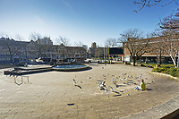 Pictured: A woman feeds seagulls in the deserted Castle Square in the city centre of Swansea, Wales, UK. Wednesday 25 March 2020 <br /> Re: Covid-19 Coronavirus pandemic, UK.