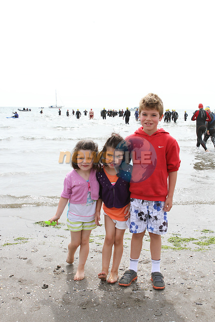 "Ríona, Róise and Brógán McCloskey at the Clogherhead ""Round the Head Swim""....(Photo credit should read Jenny Matthews/NEWSFILE)..."