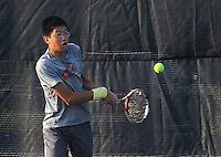 STAFF PHOTO FLIP PUTTHOFF <br /> Michael Zheng practices on Wednesday Aug. 6 2014 with the Rogers High School tennis team.
