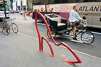 "New York, NY 21 August 2008 - One of nine bicycle racks designed by David Byrne of the Talking Heads, entitled ""Ladies Mile"" outside Bergdorf Goodman, on Fifth Avenue."