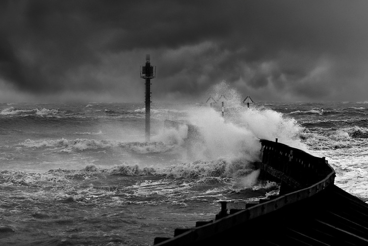 The breakwater at the Arun estuary at Littlehampton, West Sussex takes a battering during the gales of early 2014