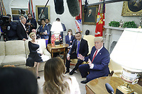 (L-R) Polish First Lady Agata Kornhauser-Duda, Polish President Andrzej Duda, US President Donald J. Trump and First Lady Melania Trump (bottom) during a meeting in the Oval Office of the White House in Washington, DC, USA, 12 June 2019. Later in the day President Trump and President Duda will participate in a signing ceremony to increase military to military cooperation including the purchase of F-35 fighter jets and an increased US troop presence in Poland. Credit: Shawn Thew/CNP/AdMedia