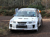 Brian Ross - Robert MacDonald in a Mitsubishi Lancer Evolution 5 competing at Junction 6 on the Munro Scotch Beef Millbuie Special Stage 1 on the 2014 Arnold Clark/Thistle Hotel Snowman Rally, supported by Highland Office Equipment, part of Capital Document Solutions which was organised by Highland Car Club and based in Inverness on 22.2.14; Round 1 of the 2014 RAC MSA Scottish Rally Championship sponsored by ARR Craib Transport Limited.