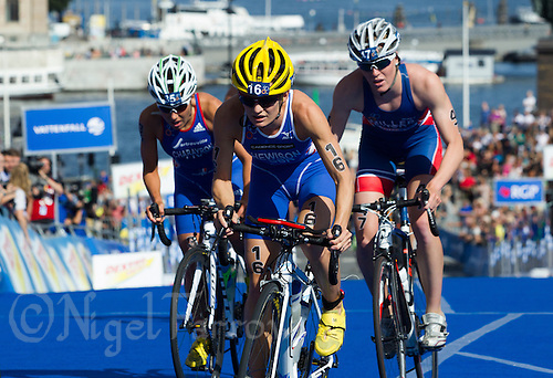 24 AUG 2013 - STOCKHOLM, SWE - Katie  Hewison (GBR) (centre with yellow cycle hat) of Great Britain   starts the next lap of the bike during the elite women's ITU 2013 World Triathlon Series round in Gamla Stan in Stockholm, Sweden (PHOTO COPYRIGHT © 2013 NIGEL FARROW, ALL RIGHTS RESERVED)