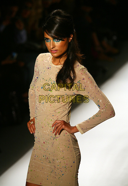 MODEL.The Richie Rich Spring 2011 Fashion Show during Mercedes-Benz Fashion Week at the Studio at Lincoln Center, New York, NY, USA..September 9th, 2010.runway catwalk half length beige dress hand on hip long sleeves paint splatter .CAP/ADM/PZ.©Paul Zimmerman/AdMedia/Capital Pictures.