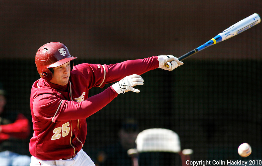 TALLAHASSEE, FL 2/13/10-FSU-BSB FANDAY10 CH17-Florida State's Mike McGee hits during Fan Day Scrimmage action Saturday in Tallahassee...COLIN HACKLEY PHOTO