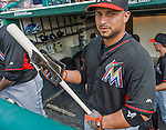 19 March 2015: Miami Marlins catcher Jhonatan Solano applies pine tar to a new bat prior to a Spring Training game against the Atlanta Braves at Champion Stadium in the ESPN Wide World of Sports Complex in Kissimmee, Florida. The Braves defeated the Marlins 6-3 in Grapefruit League play. Mandatory Credit: Ed Wolfstein Photo *** RAW (NEF) Image File Available ***