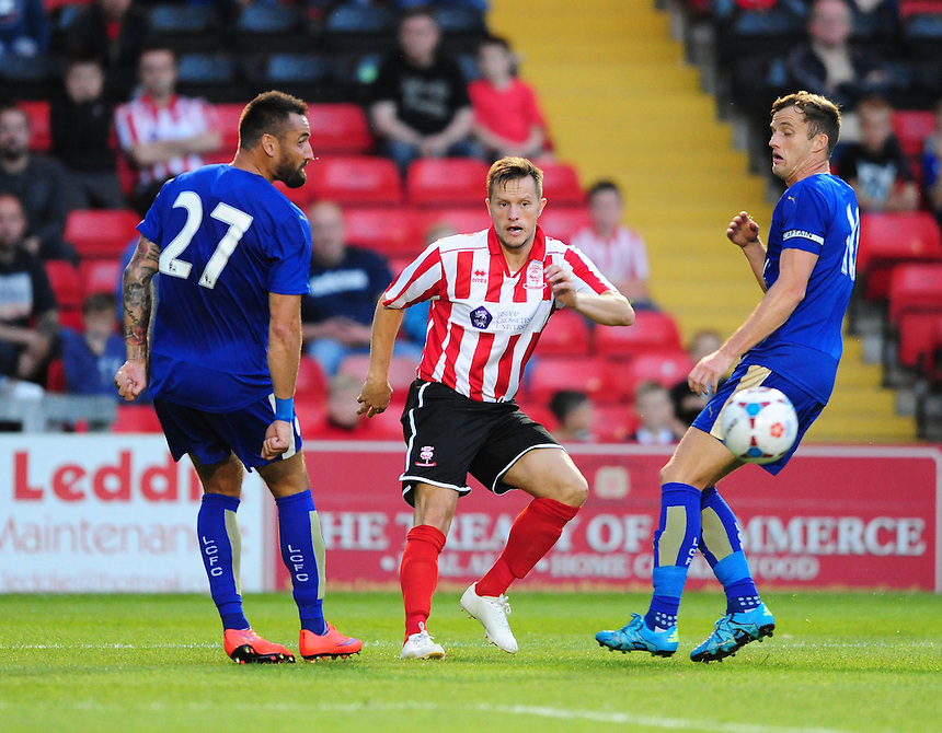 Lincoln City&rsquo;s Shaun Harrad vies for possession with Leicester City&rsquo;s Marcin Wasilewski, left, and Leicester City&rsquo;s Andy King<br /> <br /> Photographer Chris Vaughan/CameraSport<br /> <br /> Football - Football Friendly - Lincoln City v Leicester City - Tuesday 21st July 2015 - Sincil Bank - Lincoln<br /> <br /> &copy; CameraSport - 43 Linden Ave. Countesthorpe. Leicester. England. LE8 5PG - Tel: +44 (0) 116 277 4147 - admin@camerasport.com - www.camerasport.com