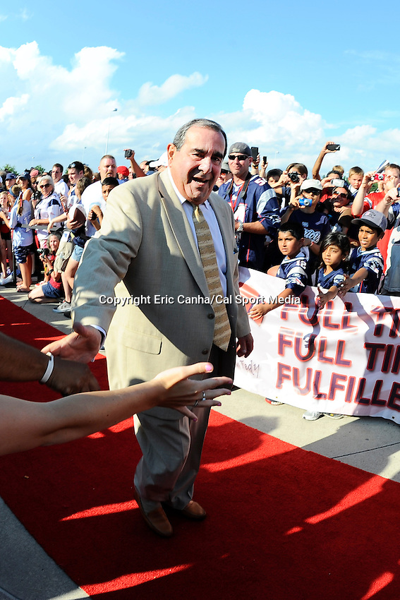 July 29, 2013 - Foxborough, Massachusetts, U.S. - Former broadcaster and Patriots Hall of Fame inductee Gil Santos walks the red carpet during New England Patriots Hall of Fame induction at Patriot Place in Foxborough Massachusetts.   Eric Canha/CSM