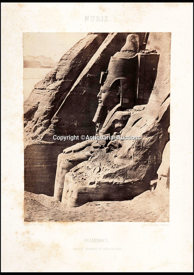 BNPS.co.uk (01202 558833)<br /> Pic: AntiquarianAuctions/BNPS<br /> <br /> The Abu Simbel statue of Rameses II - before it was moved.<br /> <br /> First Impression's - earliest prints of ancient Egypt uncovered <br /> <br /> Calotypes from the 1840's revealed the stunning architecture of the ancient civilisation to the Victorian public for the first time.<br /> <br /> The stunning collection - comprising 59 black and white images of sights including the pyramids, the Sphinx and statues at Aswan - is among the first known volumes of travel photography.<br /> <br /> Produced at a time when camera technology was still in its infancy, they were captured by Maxime Du Camp, the son of a wealthy French surgeon, between 1849 and 1851 during a government-funded expedition with his friend and literary great Gustave Flaubert.<br /> <br /> They are being sold by Antiquarian Auctions in an online sale which ends on Thursday.