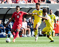 CLEVELAND, OH - JUNE 22: Edgar Barcenas #10 attacks around Elliot Bonds #4 and Samuel Cox #8 during a game between Panama and Guyana at FirstEnergy Stadium on June 22, 2019 in Cleveland, Ohio.
