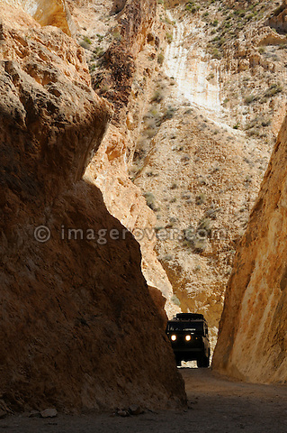 Africa, Tunisia, nr. Saket. Historic Land Rover Series 2a ascending through the famous narrow gorge south of Saket. --- No releases available, but releases may not be needed for certain uses. Automotive trademarks are the property of the trademark holder, authorization may be needed for some uses.